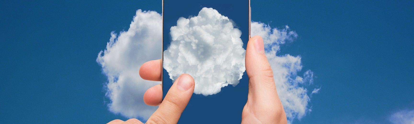 A mobile phone with a photo of a cloud